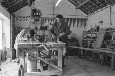Glyn Rees and his son working on carving Eglwys...
