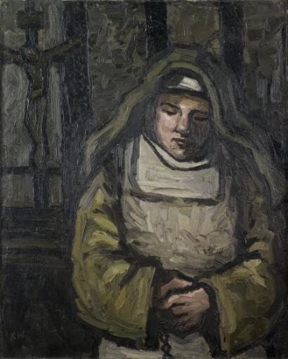 Nun at a crucifix