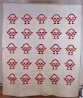 Patchwork quilt featuring red basket design,...