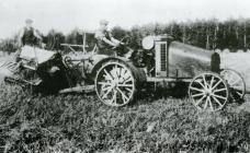 One of the first tractors and corn binders in...