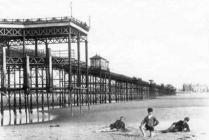 Photograph of Rhyl pier and beach, c.1900