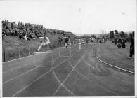 Hurdle race, UCW Aber Penglais running track, 1953