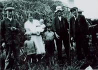 Thomas family harvesting at Southgate, Aberystwyth