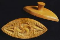 Two canoe-shaped butter prints, decorated with...
