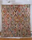 Patchwork quilt featuring diamond pattern, c....