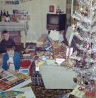 Opening Christmas presents in a Prefab, 60s