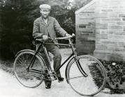 Thomas Daniel posing with his bicycle