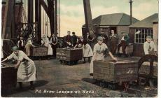 Postcard showing pit brow lasses at work