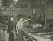 Men at work in rolling mill, aluminium works