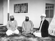 Three Imams kneeling in Severn Road Mosque,Cardiff