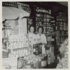 Two shop assistants at James' Stores,...