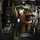Workmen in chocks on face, Maerdy Colliery, 1975