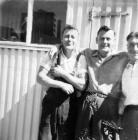 Friends outside a prefab garden shed