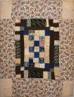 Patchwork cot quilt