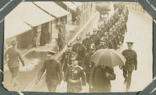 A police/military procession through Cardigan[?...