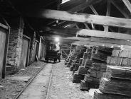 J. H. Williams unloads a wagon of slate,...