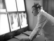 Dr Biagi studying x-rays, Llangwyfan hospital,...
