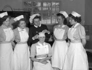 Nurses receiving first aid treatment in a class...