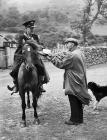 The postman arrives at Cwm Berwyn where he is...