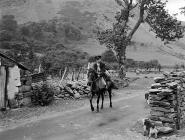 A postman visiting some of the remote farms on...