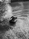 Man with his coracle on the river Teifi, near...
