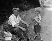 Cornelius Edwards, a roadworker, talking to...