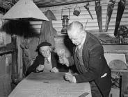 Robert Hughes, Barmouth, and companion, carving...