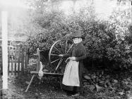 Margaret Evans and her spinning wheel,...