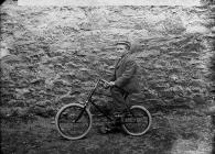 Boy on a bicycle, c. 1885