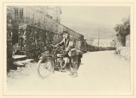 T. H. Parry-Williams and his motorbike, KC 16,...