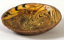 Press-moulded earthenware dish, made at...