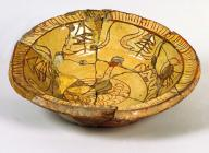 Slip-decorated earthenware dish with sgraffito...