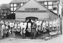 John Eaton outside his butcher shop, Montgomery...