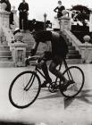 A cyclist in Carmarthen Park, c. 1900
