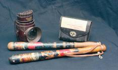 A policeman's truncheon, light and bag,...