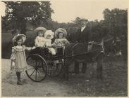 Charles Jones, his children and a donkey cart,...
