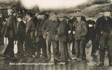 Postcard: 'Sons and brothers waiting at...