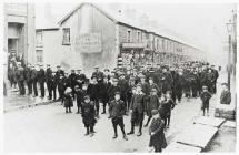 Unemployed miners march along Richard St.,...