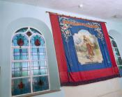 Banner and stained glass windows of Tabernacl...