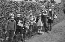 Children wearing their gas masks, 1939