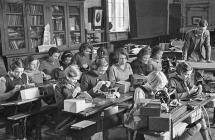 Schoolgirls in Oswestry learning sewing skills,...