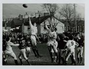 Swansea's Mervyn Davies leaps for the ball...