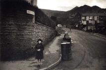 A young girl stands at the end of Moy Road,...