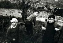 Three boys look down at the Aberfan Cemetery in...