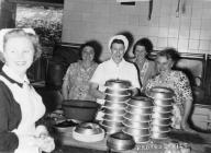 Llangollen. Women in the kitchen of the Bridge...