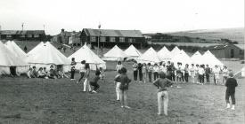 Llangrannog Urdd Camp with tents and wooden cabins
