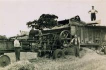 Ken and Geoff Lewis threshing, 1950s