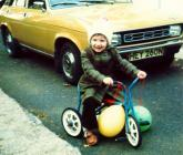Child on trike in front of Austin Allegro, 1970s