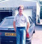 Man next to Ford Fiesta, 1990s