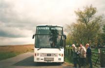 Men boarding bus